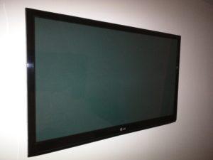 A hotel room's flatscreen TV